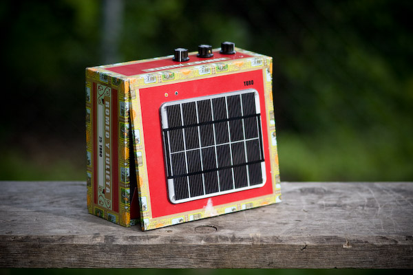 A picture of the solar powered Stella Amp, with the solar panel mostly facing the camera.